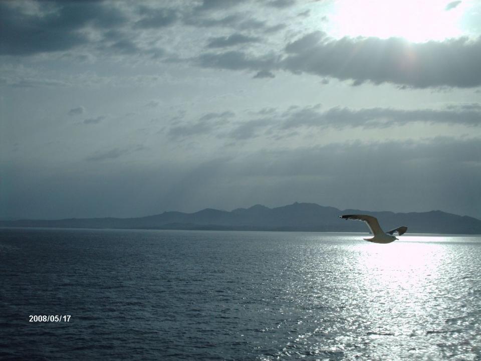 foto al tramonto in Arrivo in Sardegna al tramonto