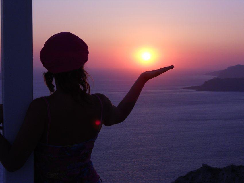 una foto di tramonto dal'isola di Santorini in Gracia  ilmiotramonto.com